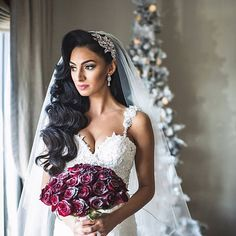 Breathtaking winter princess bride Marisa. Crystal encrusted bridal comb from our boutique!