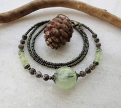 This spring green prehnite sphere necklace is unique yet subtle... perfect for everyday wear! The prehnite has a luminous fresh green color, which captures the light beautifully and almost seems to gl