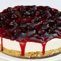 This smooth and creamy black cherry cheesecake recipes is topped with a black cherry sauce is decadent and delicious.. Black Cherry Cheesecake Recipe from Grandmothers Kitchen.