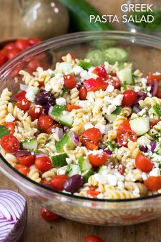 Greek Pasta Salad is an easy side to prep ahead and a hit at every party or potluck! Pasta, ripe juicy tomatoes, crisp cucumbers, feta cheese and olives are tossed in a Greek dressing for the perfect