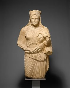 Limestone statue of Aphrodite holding winged Eros  Period:     Classical Date:     late 4th century B.C. Culture:     Cypriot Medium:     Limestone