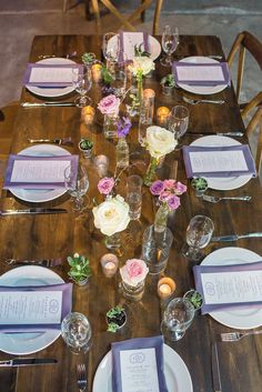 Rustic Garden Wedding Reception Table Decor with Farmhouse Table, Wooden Chairs, and Ivory and Purple Floral Centerpieces | Tampa Wedding Florist Andrea Layne Floral Designs