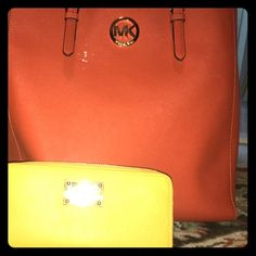 Orange purse and bright yellow wallet. Excellent condition. Only used a few times from Michael Kors Michael Kors Bags Wallets