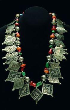 Photo © IMJ, by Ohad Matalon  Necklace  Ksar Es Souk, Tafilalet, Morocco  Silver, niello, amber, coral, glass, and silver beads  L 82 cm; L ...