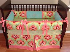 Lovely Vanessa Baby Bedding  Included in this modern 3 piece crib set is the bumper, soft minky fitted crib sheet, and tailored box pleat crib skirt with detail border.  There is lots of detail in this custom set including soft aqua minky, coral pink grosgrain ties and trim, and designer cotton sateen damask print.