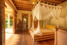 #beautiful and #romantic #bedroom with #canopybed and marvelous garden view thanks to the window bay.