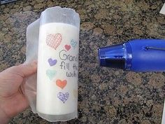 Here is a fun project for the kids!!!  So cool!!! Draw on wax paper with permanent markers, wrap around candle and heat until image is transferred... I never would have thought. Would make a great gift!!! Share this with friends and family