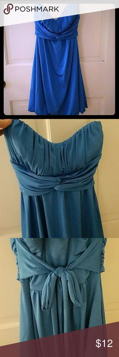 Flirty blue strapless party dress size M This is a super comfortable,  fun strapless dress with ruching on top and a bubble hem.  Ties in back.  Silky polyester spandex blend, juniors size M, but will likely fit a dress size 2-6. Worn twice, in excellent used condition. Make me an offer!!! Speechless Dresses Strapless