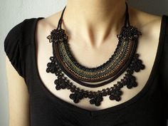 Beaded necklace - crocheted with black, gray, brown and go… | Flickr