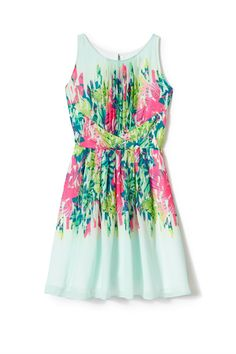 Give the lush scenery a run for its money with a flirty frock that's as colorful as any field of flowers. DRESSBAR Fashion Studio Floral Fit & Flare Dress, $48; dressbar.com   - MarieClaire.com