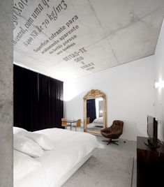 Casa Do Conto. Hotel, Portugal. By Pedra Liquida. Cast concrete typography & crossed wood patterns.