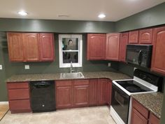 Sunset Maple kitchen cabinets with a nice green wall color