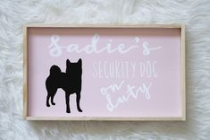 Shiba Inu dog silhouette on grey painted wood. Hand painted dog decor. Etsy shop handmade items. Black dog silhouette on grey wood. Gray wood. Grey wood. Shiba Inu silhouettes. Black and white border collie. Black and white silhouette. Custom Silhouette with dog's name. Personalized silhouette. Gift for dog people. Nursery Decor. Kids Room decor with dogs. Dog themed nursery or kids room decor. Security dog on duty. Guard dog on duty.