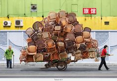 Totems series by Alain Delorme shows Shanghai workers carrying unbelievable piles of goods on bikes and carriages. See more here http://www.alaindelorme.com/?p=works=totem