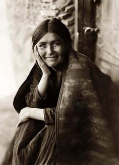 "indigodreams:  indypendenthistory:  ""Navaho Smile"". It was taken in 1904 by Edward S. Curtis"