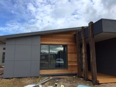 Built by Pivot Homes - A stylish contemporary home which uses three main cladding types to give it that wow factor. James Hardie Scyon Matrix, natural timber cladding as well as rendered foam. Three reclaimed timber posts welcome guests to this house in majestic style.