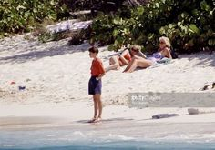 April 11, 1990: Diana, Princess Of Wales, Wearing A Bright Red Bikini And Sunglasses, Lying On The Sand Next To Her Mother, Mrs Frances Shand-kydd, During A Spring Holiday To The Remote Island Of Necker.