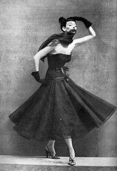 Dorian Leigh wearing strapless cocktail dress by Balenciaga, photo Richard Avedon, Vogue, Sept. 1952