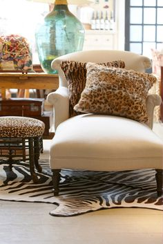 ANIMAL MAGNETISM: More is definitely better when it comes to animal prints…every room should have a little leopard or zebra.