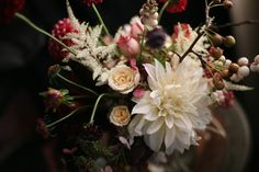 pink, red, cream and white wedding bouquet of roses, dahlias, astilbe and berries | floral design: Amy Merrick