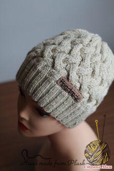 Вяжем шапку плетенку спицами видео