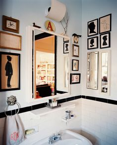 Bohemian Traditional Bathroom    Framed silhouettes and a monogrammed hand towel in a bathroom with white subway tile  Details: Gray Bohemian-Traditional Bathroom  Keywords: Bathroom Mirror, Bathroom Tiles, Silhouette, Angel Dormer, January February 2011 Issue, Bathroom Art, Bathroom Towel Ring, Framed Art, Subway Tile  (Source: Lonny)