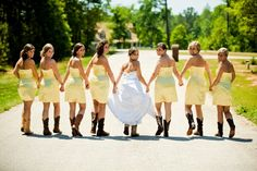 bridesmaids in cowboy boots. I'm not southern enough to do this but I think it's cute!