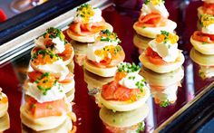 Blinis with smoked salmon recipe - By Australian Women's Weekly, These light and fluffy mini savoury pancakes make the ultimate dinner party starter or appetiser, and are divine served with a dollop of fresh cream, and tender smoked salmon.