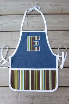 Little boy apron......going to put a necktie on it instead of letter.
