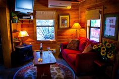 I like some of the ideas from the Wimberley Cabin. I think I need to put the tv on the wall after this one dies. Also I need a small table in front of the couch. This picture feels very homey.