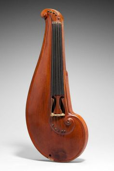 Beautiful.  I don't play the violin so have no idea if it plays well but is lovely.  Violin, Emery M. Wood (about 1907)