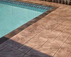 Colour might work with existing pavers stamped concrete around pool - Google Search