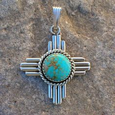 Sterling Silver Handmade Southwestern Zia Sun Symbol New Mexico 100 Centennial Bolos Pins Pendants Cuff Links and Jewelry by Native Santa Fe Silversmith and Spanish Market Award-winning Precious Metals Artist Gregory Segura with Turquoise Inlay