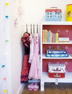 tension rod between dresser and wall for dress up clothes.....I so need to do this for my girls so they can actually keep their clothes in their dressers lol
