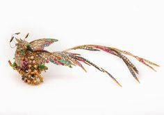 This brooch is INSANE. Gold, silver, rubies, sapphires, diamonds, with enamel highlights. oh and it's 5 inches wide. sweet jesus.