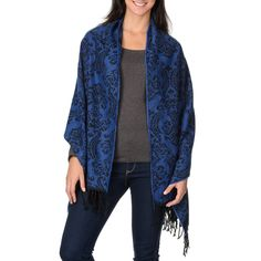A dramatic Fleur de Lis print makes this shawl wrap a timeless classic. This versatile accessory is finished with fringed edges for a vintage-inspired touch.