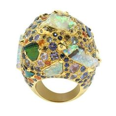 Paris-based designer Sylvie Corbelin encrusts this gemologically delicious ring with chunky opals and colored stones