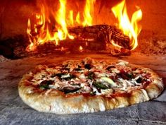 Pizza in Wood Oven _ We recently enjoyed some pizzas cooked by Joe Mishler using Joe's sauce recipe. Joe is the Executive Chef at Devon Seafood Grill in Hershey, PA, so you could say that he knows cooking! Use this recipe as it is, or adjust amounts or ingredients to make it your own. Cooking outside on a wood-fired oven adds smoky flavor & makes the whole experience even better. Enjoy!