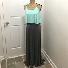 Maxi dress Beautiful long maxi dress with adjustable straps.  Top part is a light minty color.  Worn once, like new.  Very stretchy material, has some weight to it.  Use offer button, please.  No trades or PP.  Comment for more info if interested!  Charming Charlie Dresses Maxi