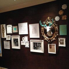 LOVE this collage wall . . . .ESPECIALLY the framed faux deer head :)