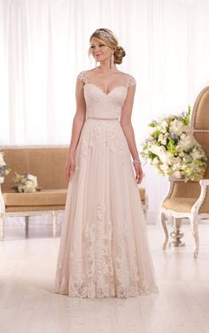 Your Dream Bridal // Spring 2016 This gorgeous lace over matte-side Lustre satin A-line wedding gown from Essense of Australia features sparkling beading, a head turning illusion back, and elegant cap sleeves in lace. A 1/2″ grosgrain ribbon belt accentuates the waist, while the fitted bodice and sweetheart neckline frame the face. Available in a myriad of dress colors, this dress zips up under matching fabric-covered buttons. http://www.yourdreambridal.com