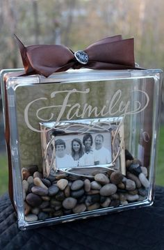 ! Glass block, river rocks and a framed picture inside. This would be an awesome memory wall/photo of blocks! some w sand and sea shells from trips !