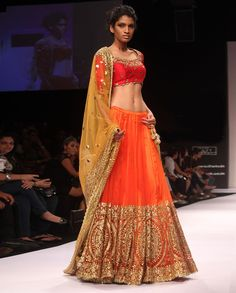 Flame Orange Lengha and Blouse  by Preeti S. Kapoor. I know this is really bright, but I love it! I like how the work is only on the bottom of the lehnga and how the blouse is 3/4 length.