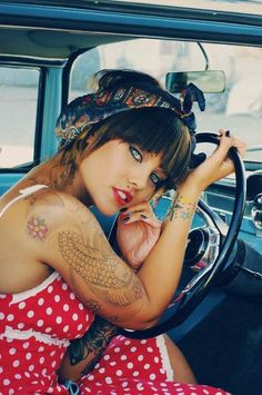 Slight rockabilly feel with the tattoos and heavy eye make up. Really like the quirkiness to this