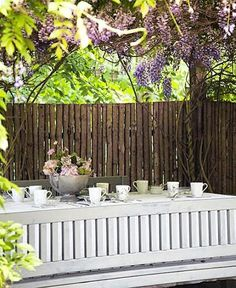 Tea-time under the Wisteria tree. You can find more info about Jette's Garden visits at www.jettefroelichshave.dk #jettesgarden #wisteriatree #garden #gardenvisits #jettefrölich #jettefroelich #jettefrölichdesign #jettefroelichdesign #danishdesign #scandinaviandesign #interiordesign #homedecor #gardendesign