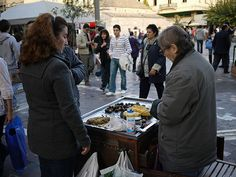 Roasted chestnuts, roasted corn. Open air vendor selling roasted chestnuts and roasted corn, Athens, Greece.