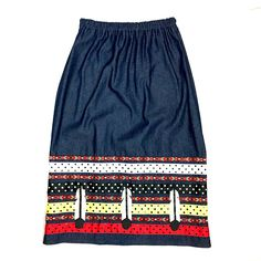 This skirt was handmade by Margaret Judy Kakenowash Azure (Turtle Mountain Chippewa) and features red, yellow, black, and white ribbon on a denim skirt. Based on the traditional ribbon skirts...