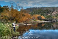 Trout  fishing  on the Derwent River in Tasmania in Autumn.  To bring out the shadow details while keeping the cloud exposure correct I HDR processed the single raw file in Photomatix    http://aviewfinderdarkly.com.au/2014/10/07/single-shot-hdr-processing-with-photomatix-pro-and-lightroom/