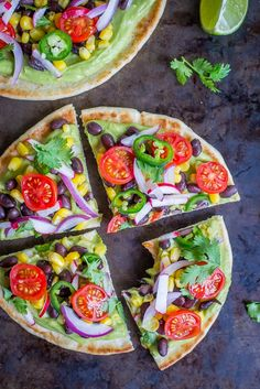 Guacamole Pita Pizzas- A delicious and easy 20 minute vegan no cook dinner that is packed with lots of healthy vegetables!