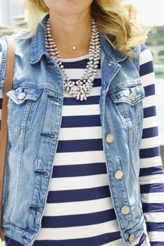 Cute outfit with a jean jacket-style vest and a striped dress.  Could you pull this off?